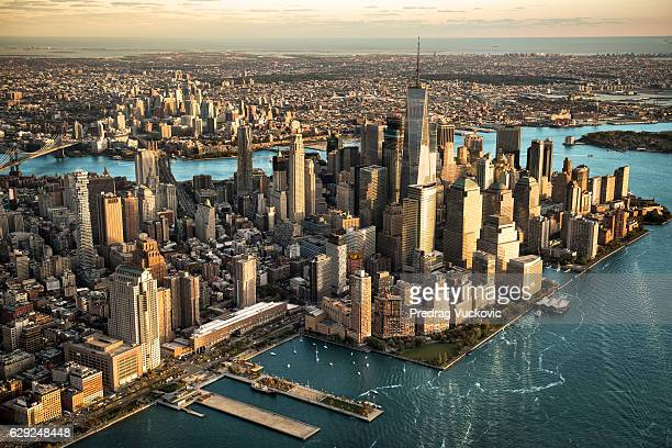 aerial view of manhattan island - new york skyline stock photos and pictures