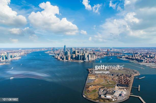 aerial view of manhattan skyline and governors island - governors island stock pictures, royalty-free photos & images