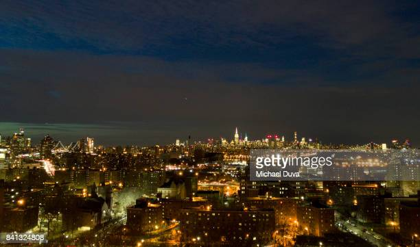 Aerial view of Manhattan skyline at night from Brooklyn