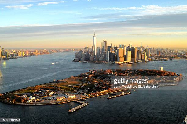 aerial view of manhattan with governors island in foreground - governors island stock pictures, royalty-free photos & images