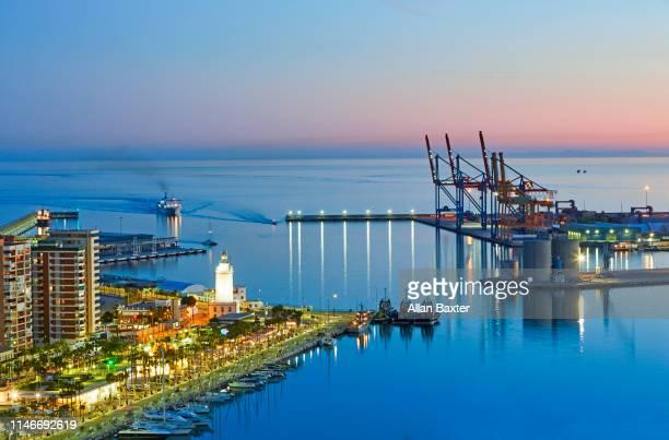 aerial view of marina and dock of malaga at twilight - quayside fotografías e imágenes de stock