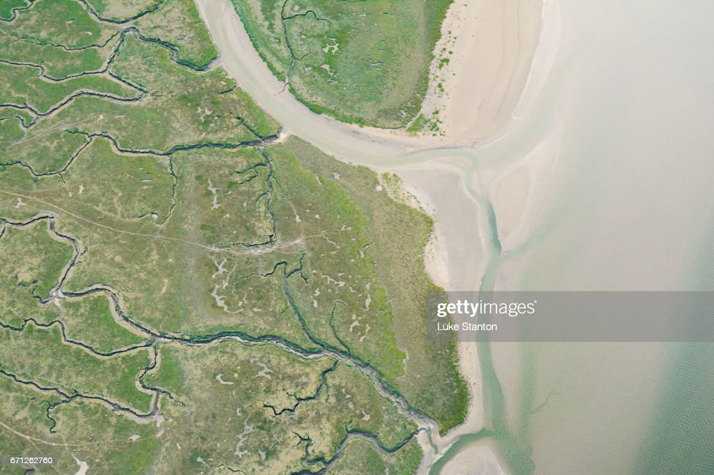 Aerial view of marshes and shoreline in Wales : Stock Photo