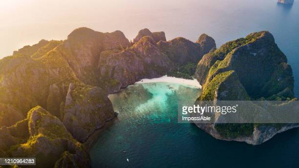aerial view of maya beach, phi phi le island during morning, andaman sea , krabi, thailand - impossiable stock pictures, royalty-free photos & images
