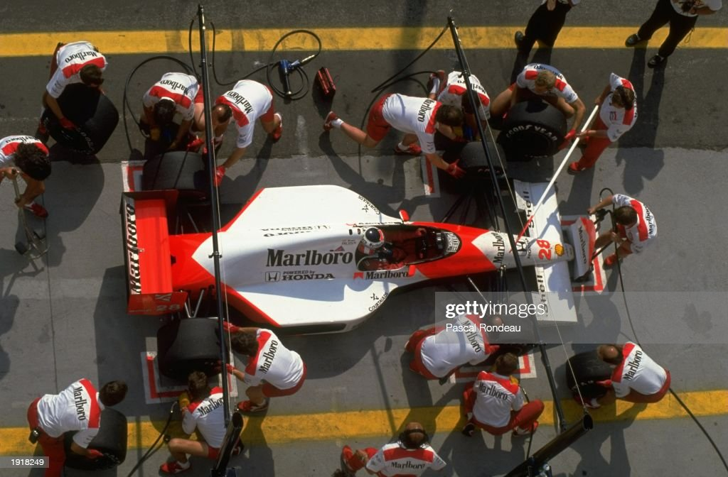 Aerial view of McLaren Honda driver Gerhard Berger of Austria during a pit stop at the Hungarian Grand Prix at the Hungaroring circuit in Budapest, Hungary. Berger retired from the race after a collision with Scuderia Ferrari driver Nigel Mansellof Great Britain. \ Mandatory Credit: Pascal Rondeau/Allsport