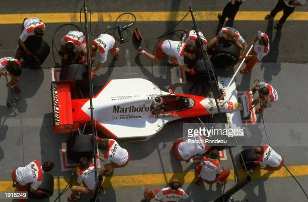 Aerial view of McLaren Honda driver Gerhard Berger of Austria during a pit stop at the Hungarian Grand Prix at the Hungaroring circuit in Budapest...