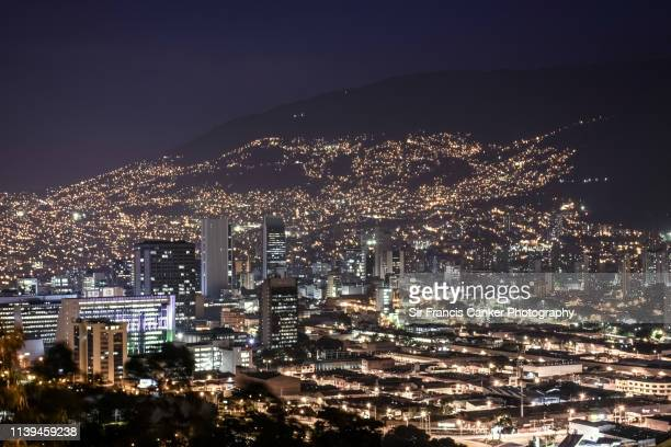 aerial view of medellin skyline illuminated at late dusk in antioquia, colombia - medellin colombia stock pictures, royalty-free photos & images