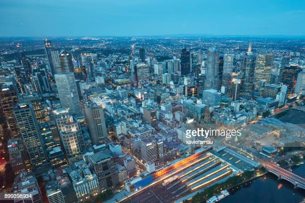 aerial view of melbourne at dusk, australia - melbourne australia stock pictures, royalty-free photos & images
