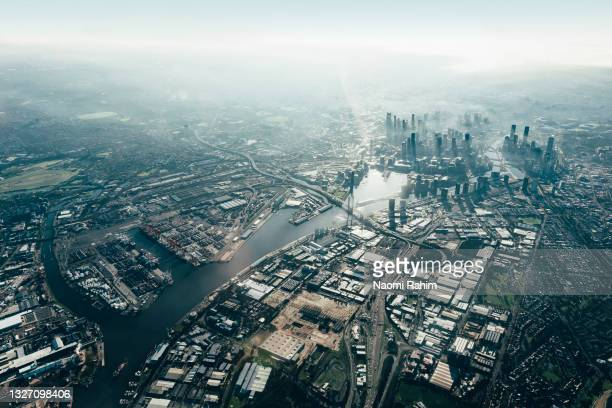 aerial view of melbourne cbd, yarra river and surrounding suburbs - docklands stadium melbourne stock pictures, royalty-free photos & images