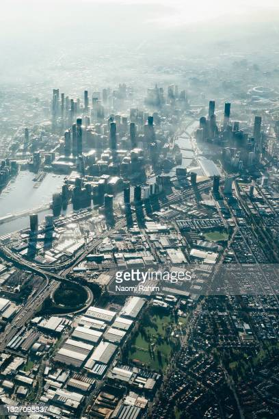 aerial view of melbourne city, industrial and urban sprawl areas in morning light - docklands stadium melbourne stock pictures, royalty-free photos & images