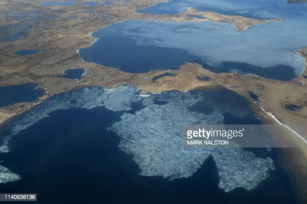 Aerial view of melting permafrost tundra and lakes near the Yupik Eskimo village of Quinhagak on the Yukon Delta in Alaska on April 12, 2019. -...