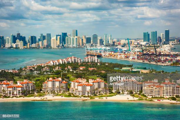 aerial view of miami florida with fisher island in foreground - fisher island stock pictures, royalty-free photos & images