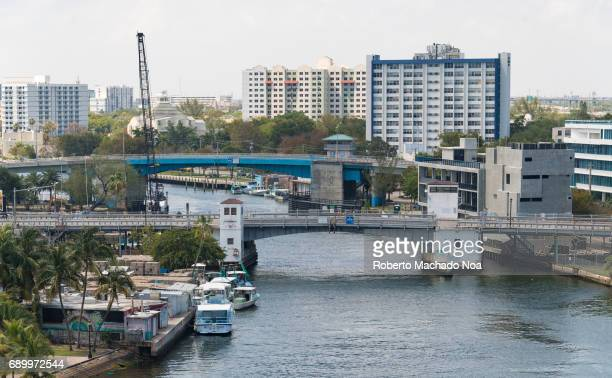 Aerial view of Miami River in daytime surrounded by the modern architecture of the city The river it is the shortest working river in the states and...