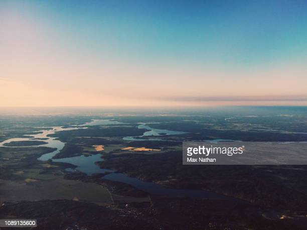 aerial view of midsummer meadows, rivers and lakes at dusk, sweden - midsummer sweden stock pictures, royalty-free photos & images
