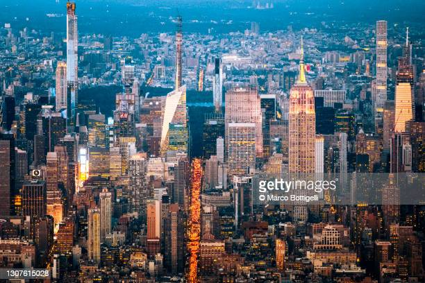 aerial view of midtown manhattan at dusk, new york city - manhattan new york city stock pictures, royalty-free photos & images