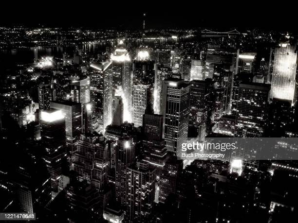 aerial view of midtown manhattan at night. new york city, usa - manhattan new york city stock pictures, royalty-free photos & images