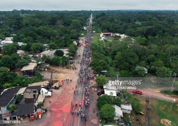 TOPSHOT Aerial view of migrants mostly Hondurans taking part in a caravan heading to the US on their way to Isla Veracruz State Mexico on November 3...