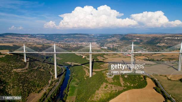 aerial view of millau city and viaduct - viaduct stock pictures, royalty-free photos & images