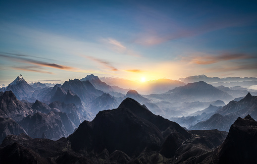 Aerial view of misty mountains at sunrise 1195458582