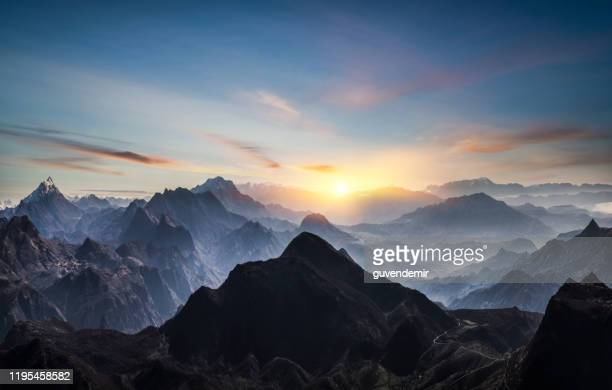 aerial view of misty mountains at sunrise - summit stock pictures, royalty-free photos & images