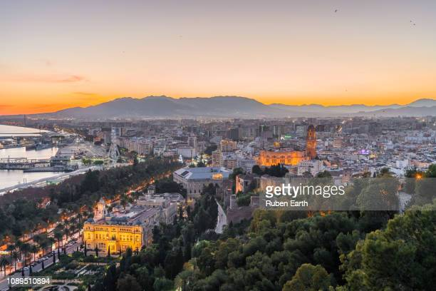 aerial view of málaga city and the illuminated cathedral - malaga photos et images de collection
