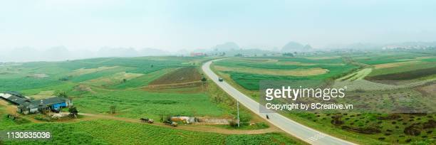 aerial view of moc chau, son la, vietnam in early morning mist. - son la stock pictures, royalty-free photos & images