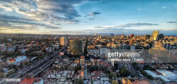 aerial view of modern buildings in city against sky during sunset - mexico city skyline stock pictures, royalty-free photos & images