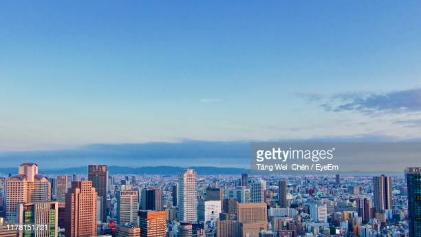 aerial view of modern buildings in city against sky - 北九州市 ストックフォトと画像