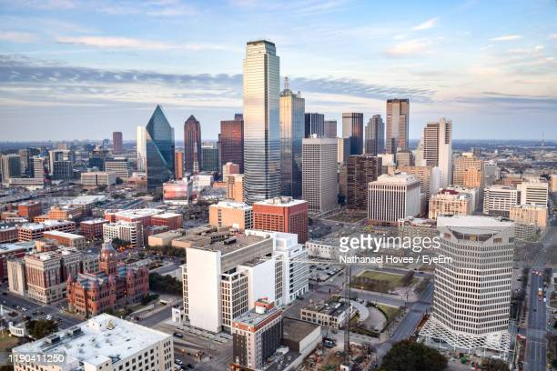 aerial view of modern buildings in city against sky - dallas texas stock pictures, royalty-free photos & images