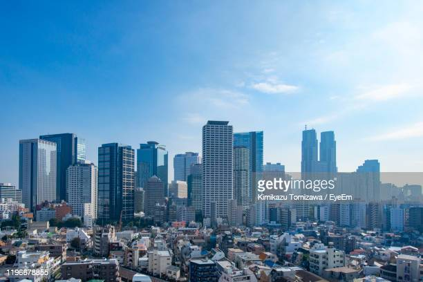 aerial view of modern buildings in city against sky - shinjuku ward stock pictures, royalty-free photos & images