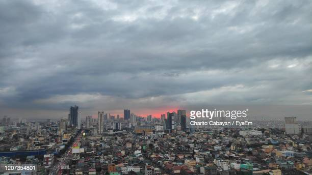aerial view of modern buildings in city against sky - manila philippines stock pictures, royalty-free photos & images