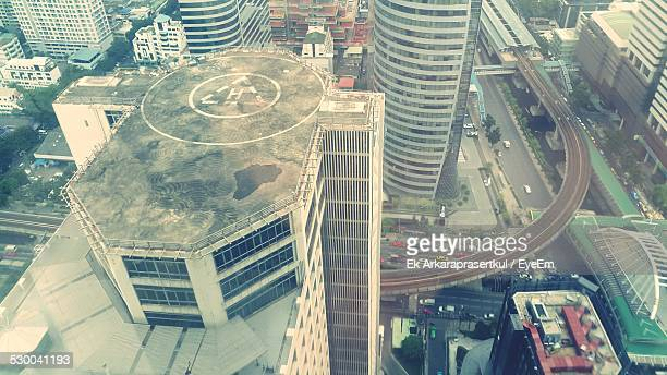 aerial view of modern buildings in city - helipad stock photos and pictures