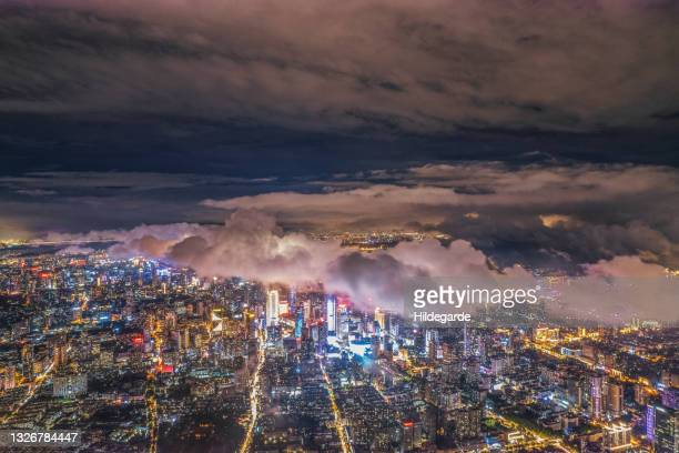 aerial view of modern city at night - province du jiangsu photos et images de collection