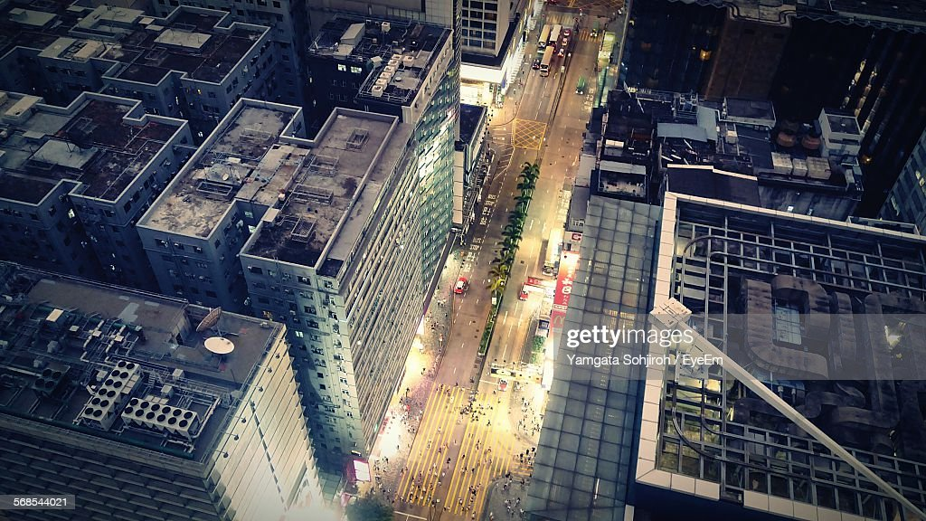 Aerial View Of Modern City Buildings By Street : Stock Photo
