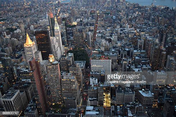 aerial view of modern illuminated buildings - carolina fragapane stock pictures, royalty-free photos & images