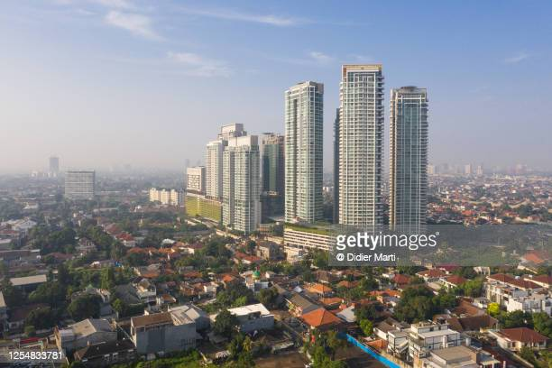 aerial view of modern luxury condo towers in the kemang residential district of jakarta, indonesia capital city - demography stock pictures, royalty-free photos & images