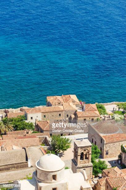 aerial view of monemvasia town and bell tower - peloponnese stock photos and pictures