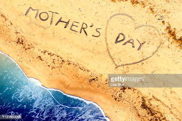aerial view of mother's day  on the beach - mothers day beach stock pictures, royalty-free photos & images