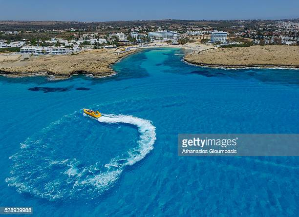 Aerial view of motorboat at Sandy Bay on April 29 2016 in Ayia NapaCyprus Sandy Bay has fine white sands and gently shelving waters It is popular...