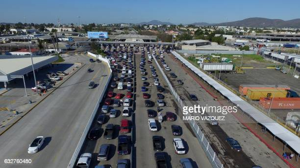 Aerial view of motorists waiting to cross the border bridge between Mexico and US at the Otay checkpoint on January 25 2017 in Tijuana Mexico US...