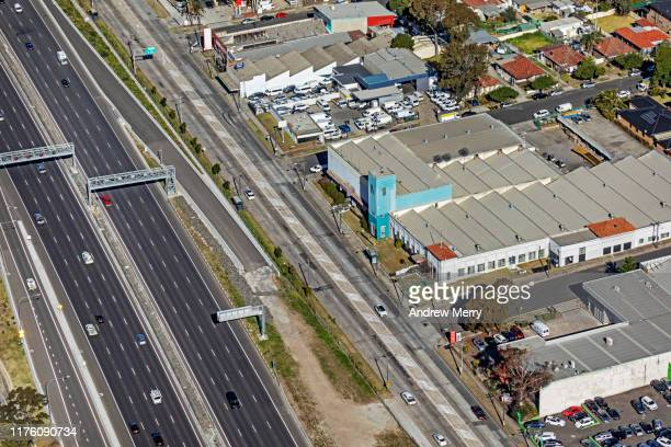 aerial view of motorway, freeway, commercial buildings and suburban houses in sydney, australia - commercial real estate sign stock pictures, royalty-free photos & images