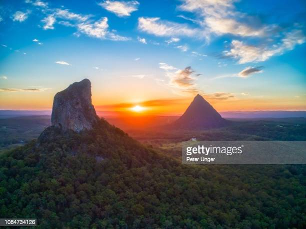 aerial view of mount coonowrin with mount beerwah in the background,glasshouse mountains,queensland,australia - glass house mountains stock pictures, royalty-free photos & images