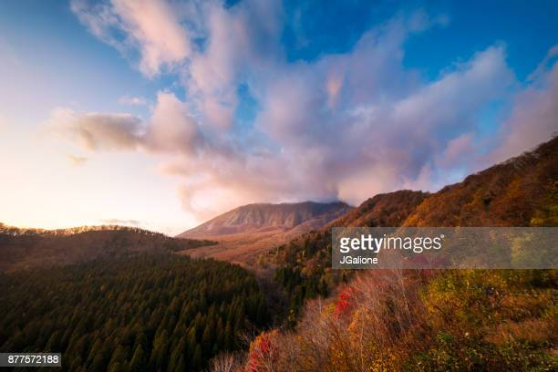aerial view of mount daisen surrounded by beautiful autumn foliage - tottori prefecture stock photos and pictures