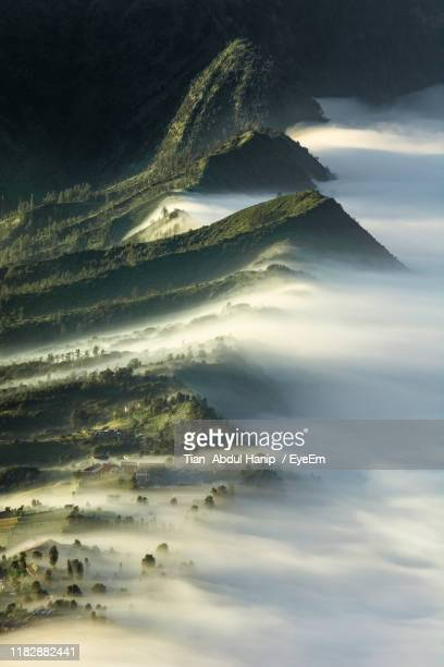 aerial view of mountain against sky - tian abdul hanip stock photos and pictures