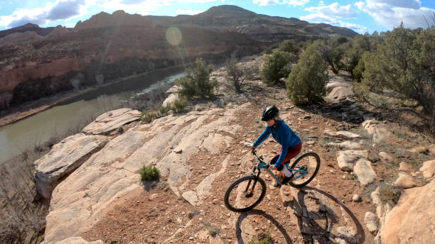 Aerial view of mountain biker on edge of canyon overlook
