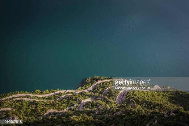 aerial view of mountain by sea - michael jaeger stock pictures, royalty-free photos & images