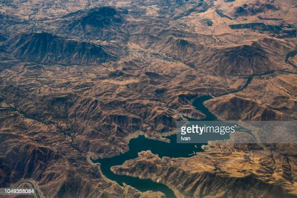 aerial view of mountain lake and dam - topography stock pictures, royalty-free photos & images