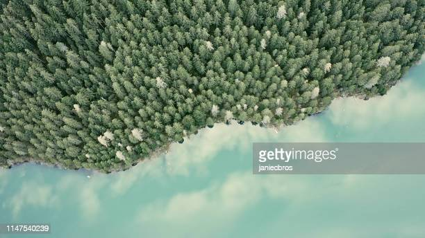 aerial view of mountain valley and turquoise river - motivo naturale foto e immagini stock