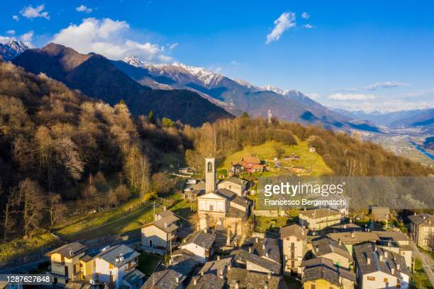 aerial view of mountain village with view on the alpine valley. - italia ストックフォトと画像