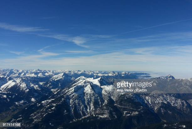 Aerial View Of Mountains Against Blue Sky