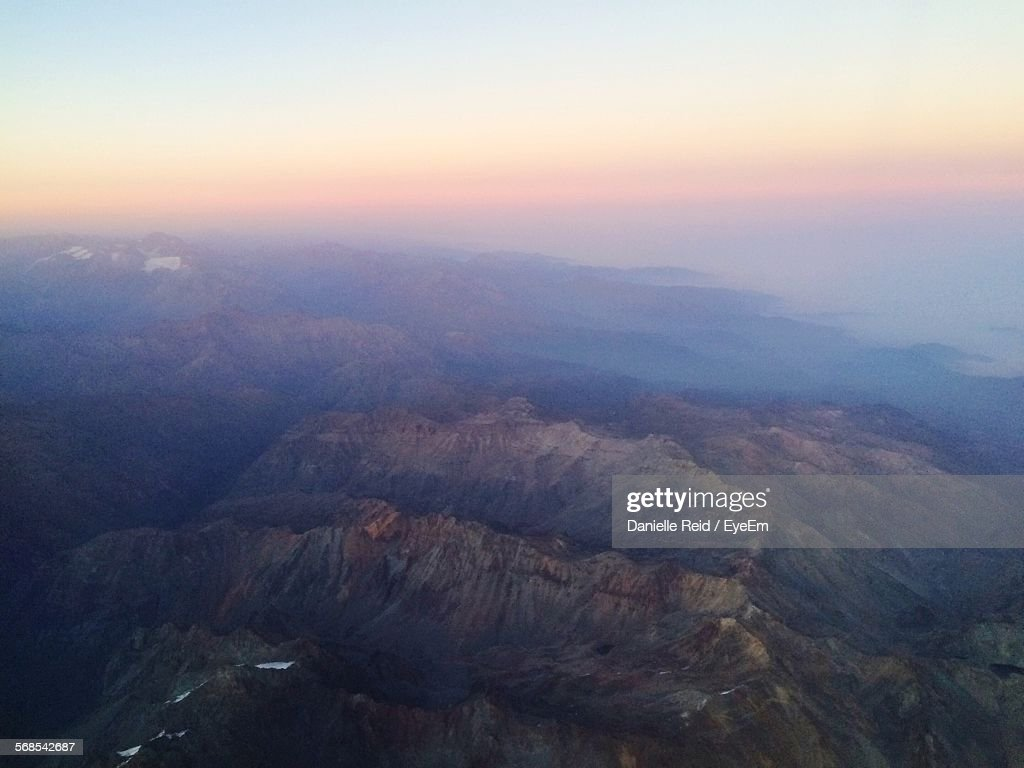 Aerial View Of Mountains Against Sky During Foggy Weather : Stock Photo